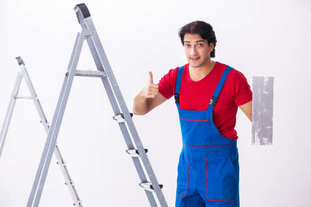 Young handsome contractor working indoors Stock Photo
