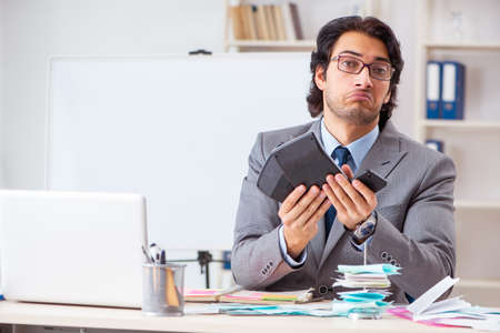 Young handsome businessman in budget planning concept Stockfoto