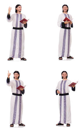Arab man with koran isolated on white