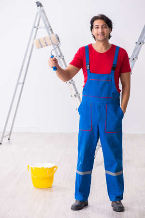 Young handsome contractor working indoors Stok Fotoğraf