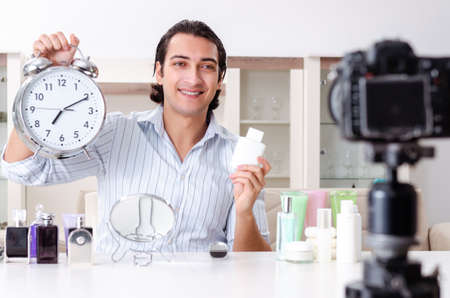 Young handsome man recording his blog in hygiene concept Stock Photo