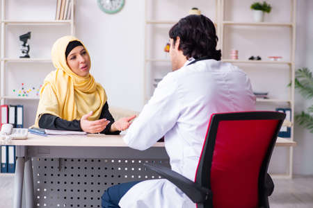 Female arab patient visiting male doctor