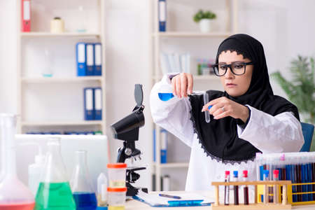 Female chemist in hijab working in the lab Reklamní fotografie