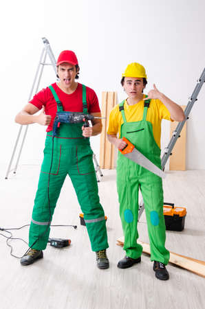 Two workers contractors working indoors