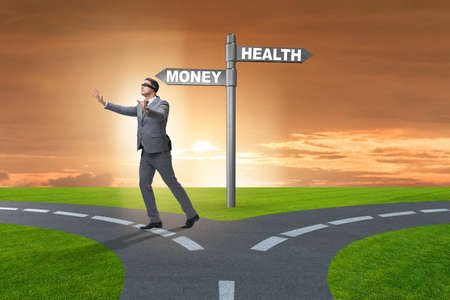 Businessman choosing between money and health Stock Photo
