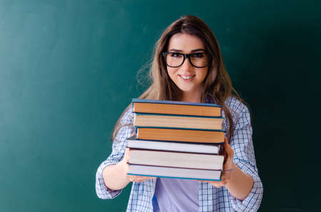 Female student in front of chalkboard Zdjęcie Seryjne - 122451977