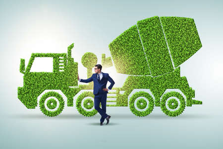 Businessman with green ecological vehicle Stockfoto