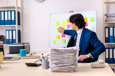 Young businessman working in the office Stock Photo