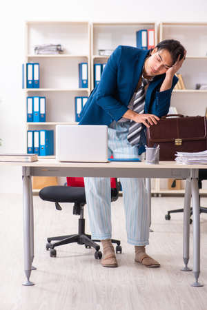 Employee coming to work straight from bed Stock Photo