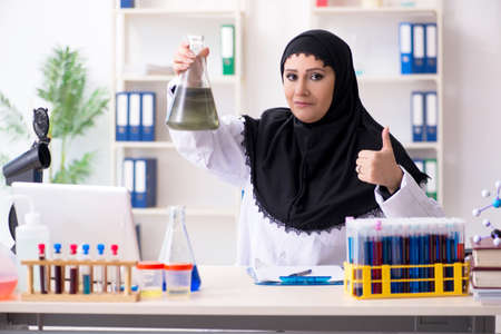 Female chemist in hijab working in the lab Stok Fotoğraf