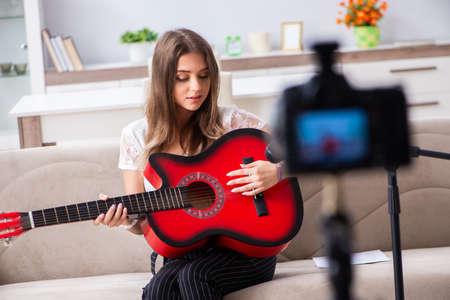 Female beautiful blogger playing guitar 写真素材