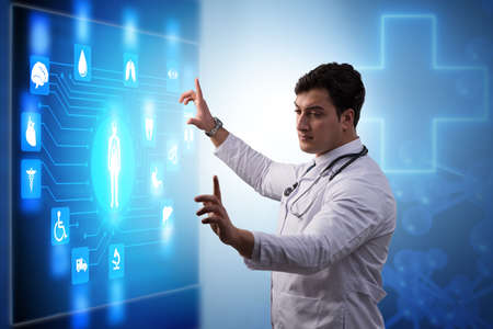 Doctor in telemedicine concept looking at screen
