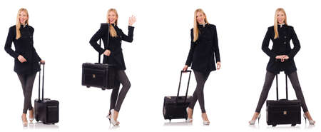 Beautiful woman in black coat with suitcase