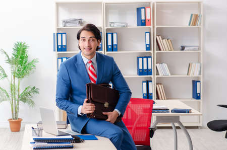 Young happy male employee in the office Stockfoto