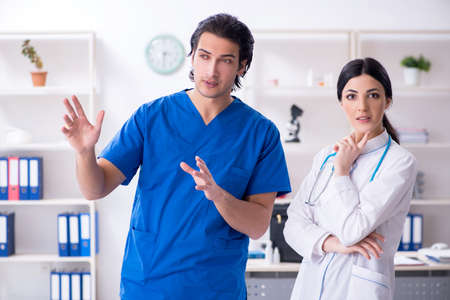 Two young doctors working in the clinic