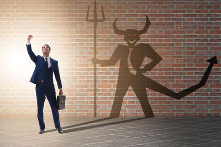 Devil hiding in the businessman - alter ego concept Stock Photo
