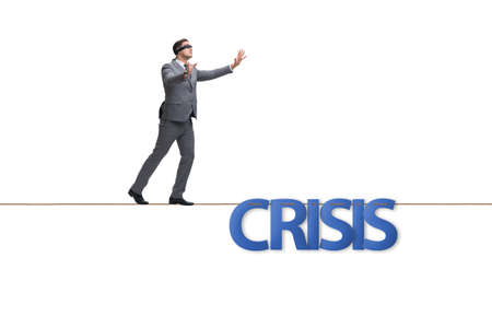 Crisis concept with businessman walking on tight rope
