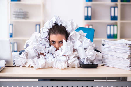 Businesswoman rejecting new ideas with lots of papers