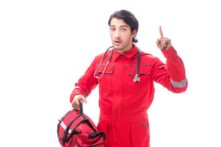 Young paramedic in red uniform isolated on white Imagens
