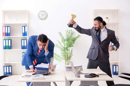 Two male colleagues in the office