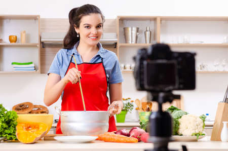 Young female vegetarian recording video for her blog