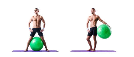 Man with swiss ball doing exercises on white background
