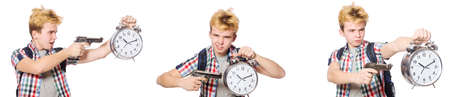 Young boy with alarm-clock and handgun Imagens