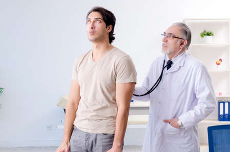 Young male patient visiting old doctor