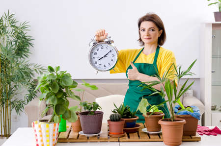 Female gardener with plants indoors