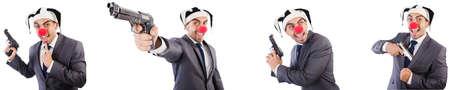 Funny clown businessman with handgun