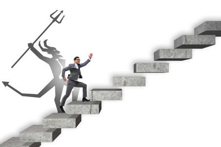 Businessman with alter ego climbing career ladder Stock Photo