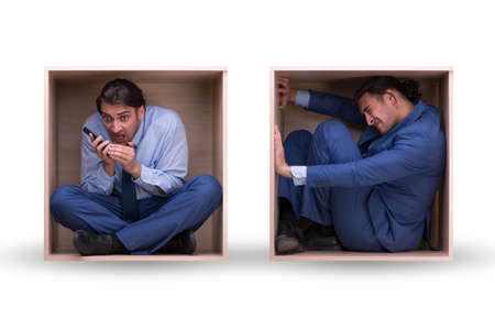 Employee working in tight space Stock Photo