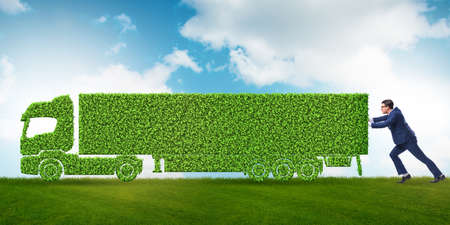 Businessman with green ecological vehicle Stock Photo