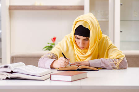 Female student in hijab preparing for exams 免版税图像