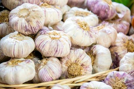 Garlic at the market display stall Stock Photo