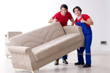 Two young contractor employees moving personal belongings Stock fotó