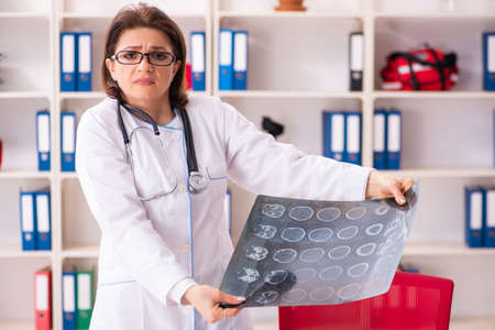 Aged female doctor radiologist in the clinic