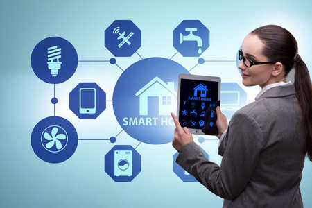 Smart home concept with woman Stock Photo