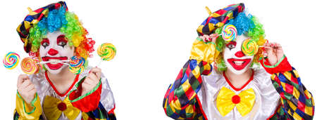 Funny male clown with lollipop