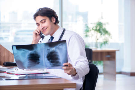 Young male doctor radiologist working in the clinic