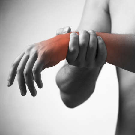 Man suffering from acute pain in wrist