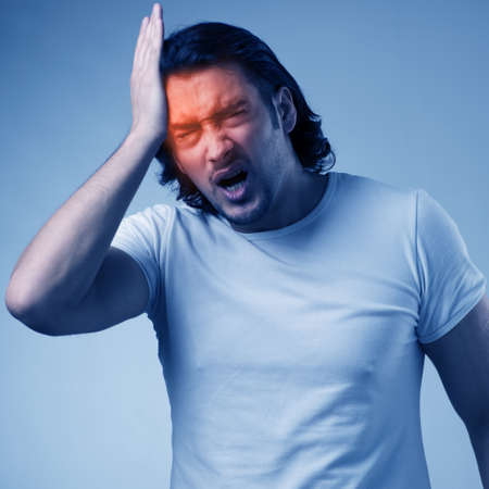 Man suffering from acute headache