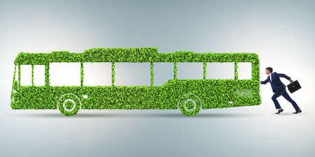 Businessman with green ecological vehicle Zdjęcie Seryjne