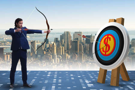 Businessman aiming arrow with bow Stock Photo