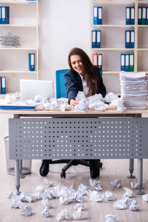 Businesswoman rejecting new ideas with lots of papers Standard-Bild