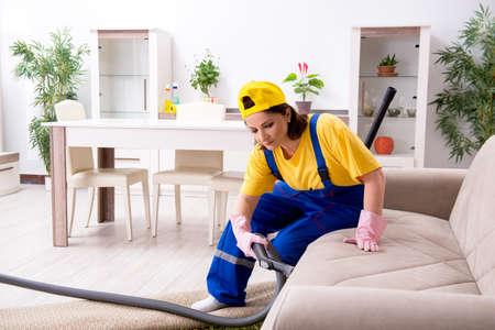 Old female contractor doing housework Banco de Imagens