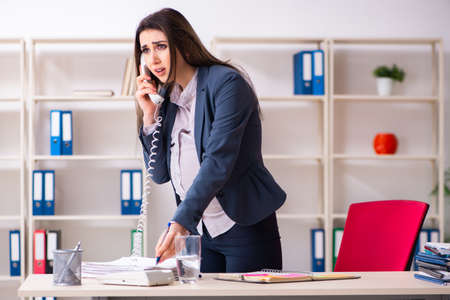 Young pregnant woman working in the office