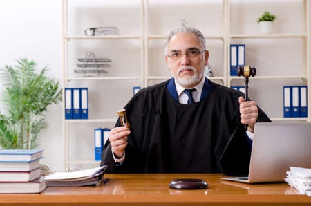Aged lawyer working in the courthouse Stock Photo