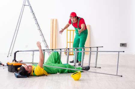 Injured worker and his workmate Reklamní fotografie