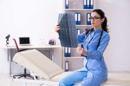 Young female doctor radiologist working in the clinic